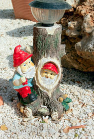 picture of  midget elves  - Two gnomes on the pebbles in the backyard - JPG