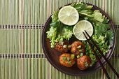 picture of chopsticks  - Traditional Asian fish balls with salad and chopsticks on a bamboo table close - JPG
