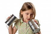 pic of tin can phone  - Girl tangled up in string from a tin can phone - JPG
