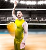 stock photo of volleyball  - Volleyball player on yellow uniform on volleyball court - JPG