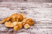 foto of crimini mushroom  - mushrooms on vintage wooden table - JPG