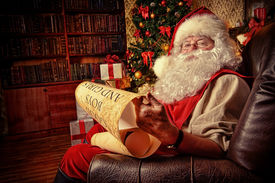 pic of boys night out  - Santa Claus dressed in his home clothes sitting in the room by the fireplace and Christmas tree - JPG