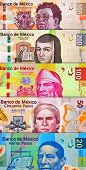 stock photo of pesos  - Mixed peso bills creating a colorful background - JPG