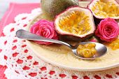 stock photo of passion fruit  - Passion fruit on plate on color napkin background - JPG