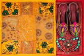 pic of flea  - Colorful ethnic shoes necklace and yellow Rajasthan cushion cover on flea market in India - JPG