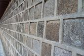 image of cinder block  - Block concrete wall closeup in view side background - JPG