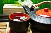 stock photo of teapot  - Green tea in a ceramic cup ceramic teapot Sakura - JPG