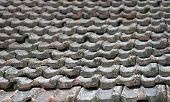 foto of red roof tile  - The roof of an old house covered with gray tiles - JPG
