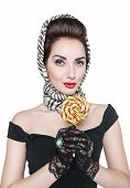 foto of lollipop  - Young beautiful woman in retro pin up style with lollipop isolated - JPG