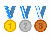 pic of award-winning  - gold silver and bronze award medals on a blue various ribbons - JPG