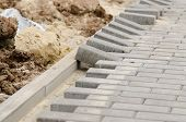 foto of paving  - Laying of paving slabs to the curb