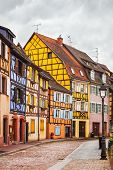 picture of timber  - Colmar Petit Venice street lamp and traditional half timbered colorful houses - JPG