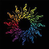 foto of clefs  - Treble and bass clefs and scores forming a radial rainbow colored flower or star - JPG