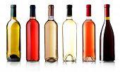 pic of merlot  - Wine bottles in row isolated on white - JPG
