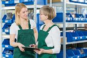 image of mums  - Mum and daughter working together in storehouse - JPG