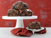 stock photo of cake stand  - Chocolate Fruit Buns on White Cake Stand on white shabby chic wood table with red wallpaper background - JPG