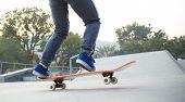 foto of skateboarding  - skateboarder riding on skateboard at skate park  - JPG