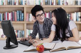 pic of indian apple  - Two asian college students studying together at class - JPG