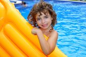 Beautiful Little Girl Holding Yellow Pool Float Smiling
