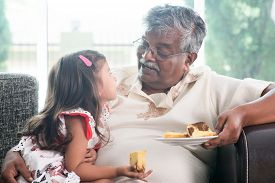 stock photo of indian  - Portrait of Indian family at home - JPG