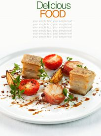 picture of pork belly  - Sliced roast pork belly on a plate  - JPG
