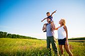 picture of happy family  - happy family having fun outdoors - JPG