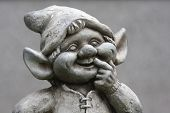 Funny dwarf, gnome with grey background