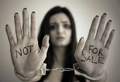 Woman in handcuffs on light background poster
