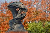 stock photo of chopin  - Chopin old bronze monument in Lazienki park in Warsaw - JPG