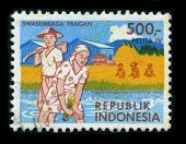 INDONESIA - CIRCA 1980: A stamp printed in INDONESIA shows image of the dedicated to the Rice is the