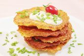 foto of frizzle  - fried pancakes from the potatoes on the plate - JPG