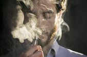 Man Vaping Electronic Cigarette With Clouds. poster