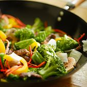 stock photo of stir fry  - wok stir fry with selective focus - JPG