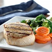 Pork loin fillet with carrots and broccoli with hollandaise sauce