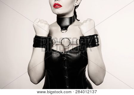 Submissive Girl In Leather Black