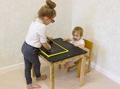 Older Sister Plays With Junior To School. Little Baby Girl Does Not Want To Play, Does Not Want To L poster