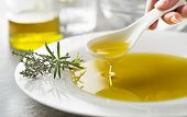 Healthy Olive Oil With Herbs Pouring With Spoon Close Up poster