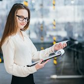 Confident Teamlead At Office Workspace. Successful Career. Young Business Woman In Glasses Hold Docu poster