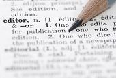 stock photo of pronunciation  - Shallow DOF focus on editor and nib of pencil - JPG