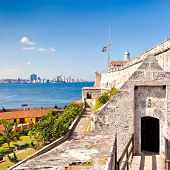 picture of el morro castle  - The famous castle and lighthouse of El Morro in Havana with a view of the city - JPG