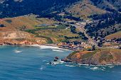 Rugged Coastal Cliffs And Pacifica State Beach In San Mateo County, Northern California, Flying From poster