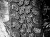 Terrain Tyre Close Up Shot On Offroad Vehicle At Roadside. poster