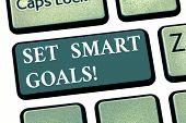 Handwriting Text Set Smart Goals. Concept Meaning Establish Achievable Objectives Make Good Business poster