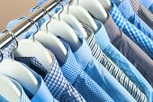Cloth Hangers With Shirts. Mens Business Clothes. Fashion poster