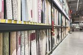 Shelves With A Large Selection Of Roll Of Wallpaper In The Store. Colorful Rolls Of Wallpaper As Bac poster