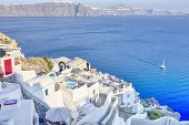 European Destinations. Amazing View Of Classic White Houses And Blue Colors Of Oia Village Houses An poster