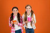 Make Sure Kids Drink Enough Water. Girls Kids Hold Cups Orange Background. Sisters Hold Mugs. Drinki poster