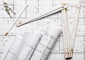 Rolls Of Architectural Blueprint House Building Plans On Blueprint Background With Folding Rule, Pen poster
