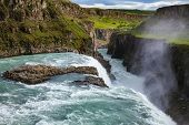 Gullfoss (Golden Falls) waterfall on the Hvítá river, a popular tourist attraction and part of the poster
