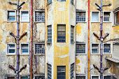 Lisbon Portugal. Old shabby grunge walls of vintage building with windows and outdoor draining pipes poster